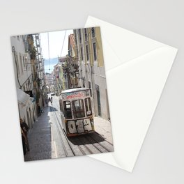 GRAY TRAM ON RAILWAY ALONG THE BUILDING Stationery Cards